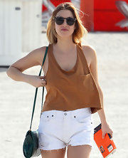 Whitney Port enjoyed a day at the beach in a camel cropped tank and high-waist cut-off shorts.