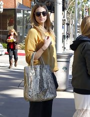 Whitney Port accessorized her mustard sweater with a surprisingly neutral snakeskin tote.