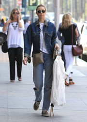 Whitney Port pulled her look together with a nude leather shoulder bag.