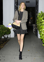 Whitney Port gave her flirty dotted dress a tough of the masculine with a plaid blazer.