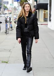 Whitney Port kept her look casual and comfy with skinny black leather pants.
