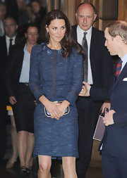 Kate Middleton looked refined in this blue tweed skirt suit with raw edging at the Royal British Legion.