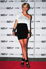 Lena wears a worn in white off-the-shoulder tee with her high-waisted mini at the William Rast fashion show.