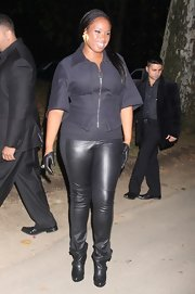 Jennifer keeps this outfit all black with these buckled ankle boots.