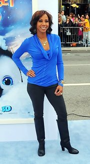 Holly Robinson Peete kept her style casual at the premiere of 'Happy Feet Two' in a blue cowl neck top and black skinny jeans.