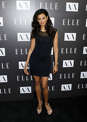 Noureen DeWulf looked sexy in a black body-hugging cocktail dress at the Elle and A/X event.