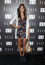 Louise Roe looked summery in a purple and beige tropical print romper.