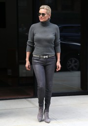 Yolanda Hadid matched her sweater with a pair of gray leather leggings.