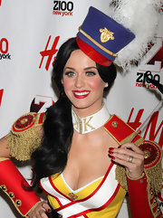 Katy Perry topped off her look with a fancy military hat.