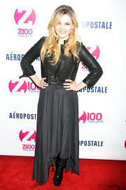 Abigail Breslin showed off her rocker side in a studded moto-jacket over a charcoal pleated dress.