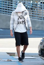 Zac Efron used his gray and white striped Abercrombie hoodie to shield his face from paparazzi.