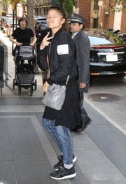 A gray leather cross-body bag completed Zendaya Coleman's ensemble.