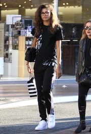 Zendaya Coleman continued the dressed-down vibe with a pair of Adidas track pants.