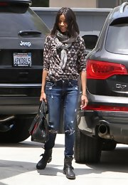 Zoe Saldana kept her travel look casual and comfy with a patterned top and distressed jeans.