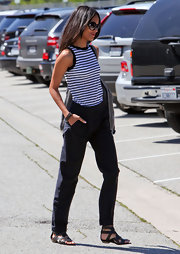 Zoe Saldana teamed her nautical inspired outfit with strappy black gladiator sandals.