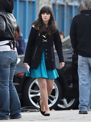 Zooey Deschanel winterized a flirty skater set on the set of 'New Girl' with a navy topper.