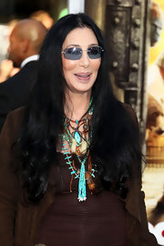 Cher injected some color into her neutral outfit with layers of beaded necklaces.