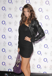 Lauren rocked a leather zip-up jacket over an asymmetrical LBD.