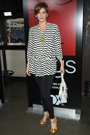 To keep her look on the casual side, Melinda McGraw chose a pair of black leggings to pair with her striped top.