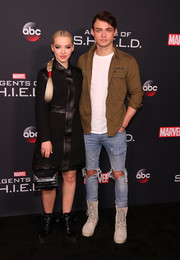 Dove Cameron attended the 'Agents of S.H.I.E.L.D.' 100th episode celebration carrying a chic black crocodile purse.