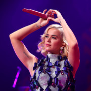 Katy Perry performed at 101.3 KDWB's Jingle Ball 2019 wearing chunky gemstone drop earrings.