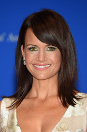 Carla Gugino sported a sleek layered cut with side-swept bangs during the White House Correspondents' Association Dinner.