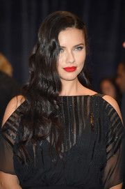 Adriana Lima amped up the Old Hollywood-glam vibe with a matte red lip.
