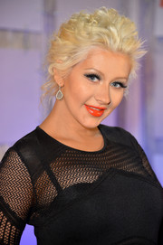 Christina Aguilera brightened up her look with a swipe of orange lipstick.