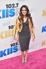 Laura Marano styled her plain dress with a metallic gold leather jacket.