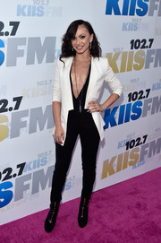 Karina Smirnoff layered a crisp white blazer over a plunging black jumpsuit for KIIS FM's Wango Tango 2016.