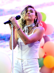 Miley Cyrus teamed a gemstone bracelet with a white cami and jean shorts for her performance at the 2017 Wango Tango.