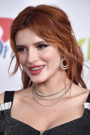 Bella Thorne attended 102.7 KIIS FM's Jingle Ball 2017 wearing three layers of tennis necklaces.