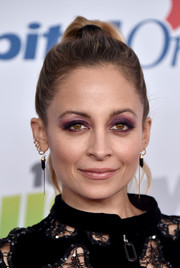 Nicole Richie played up her eyes with a smoky application of purple shadow.