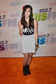 Megan Nicole chose a graphic-print tank to pair with a white and black polka dot skirt.