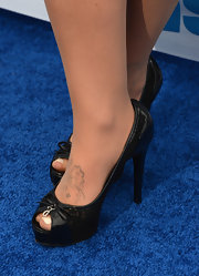 Deena Nicole Cortese wore a pair of adorable black peep-toe pumps to a radio appearance in California.