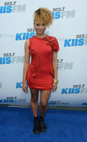 Kat Graham paired her red frock featuring zipper detailing with black leather combat boots.