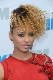 Kat Graham swept her hair up into a high ponytail featuring long springy spiral curls.