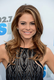 Maria Menounos arrived at a KIIS FM event wearing her highlighted tresses in long layers with subtle waves.
