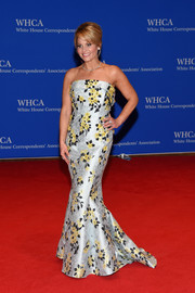 Candace Cameron Bure made a glamorous appearance at the White House Correspondents' Association Dinner in a strapless floral mermaid gown.