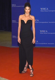 Kendall Jenner cut a shapely figure in this strapless black Vivienne Westwood gown, boasting a perfectly sculpted silhouette and an elegant side train, at the White House Correspondents' Association Dinner.