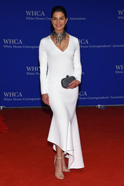 Sela Ward attended the White House Correspondents' Association Dinner wearing a modern white mermaid gown.