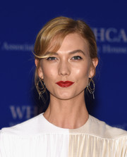 Karlie Kloss sported minimal makeup except for that bold red lip.