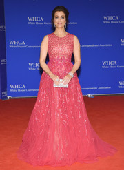 Bellamy Young looked like Barbie headed to the ball in this sparkly pink princess gown during the White House Correspondents' Association Dinner.