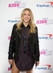 Ellie Goulding teamed a purple zip-front shirtdress with a black leather jacket for KISS FM's Jingle Ball 2016.