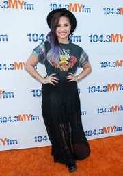Demi Lovato teamed her tee with a long black skirt for a bohemian touch.