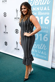 Hillary Scott displayed her curves in a black-and-white striped frock with a ruffle hem during the ACM Honors.