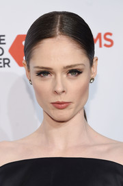 Coco Rocha pulled her hair back into a sleek center-parted ponytail for the Delete Blood Cancer Gala.