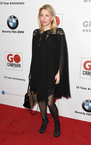 Courtney Love was goth-chic in a black lace-panel cape dress by Elie Saab at the GO Campaign Gala.