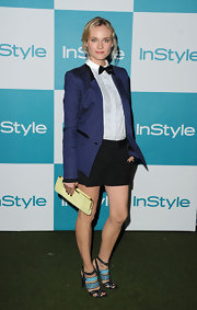 Diane Kruger was playful with her look at InStyle's Summer Soiree in Hollywood. The actress wore a Jason Wu ensemble from his Resort 2012 collection consisting of a crisp blue retro suit jacket paired with black British school boy shorts.