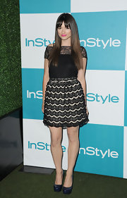 Cyrstal Reed looked romantic at the 'InStyle' Summer Soiree in a black lacy boat neck cocktail dress with scalloped pleats.